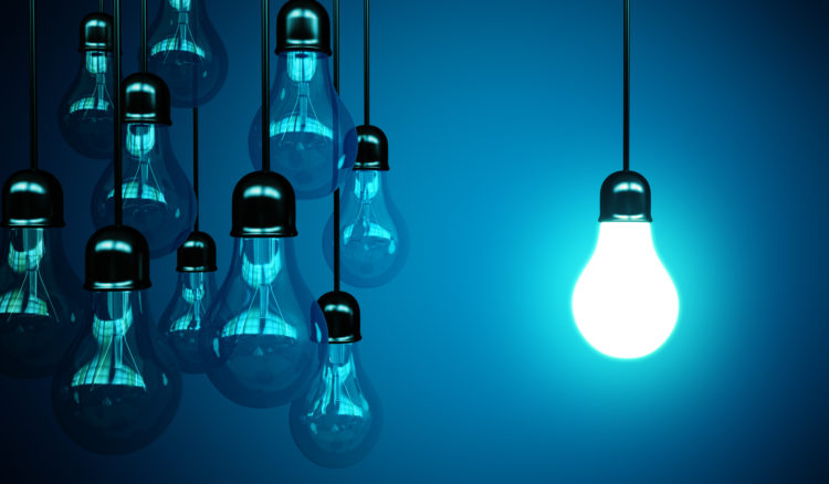 idea concept with light bulbs on a blue background